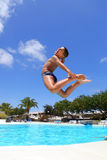 Boy jumping into the pool Royalty Free Stock Photo