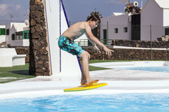 Boy jumping in the pool. Cute boy jumping in the pool Royalty Free Stock Photo