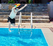 Boy jumping into the Pool royalty free stock photos