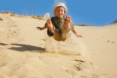 Boy jumping in sands Royalty Free Stock Photography
