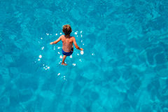 Boy jumping into sea water Royalty Free Stock Photography