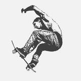 Boy jumping on a skateboard Royalty Free Stock Photo