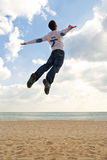 Boy jumping into the sky Stock Photo