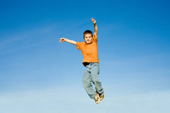 Boy Jumping into the Sky Royalty Free Stock Photo