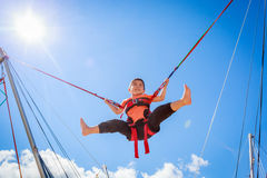 Boy. Is jumping in the sky Royalty Free Stock Images
