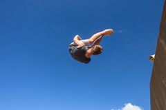 Boy Jumping Somersault Blue Parkour Royalty Free Stock Images