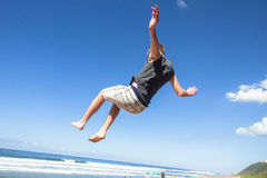 Boy Jumping Somersault Blue Sky Royalty Free Stock Photos