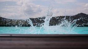 Boy jumping into swimming pool at resort