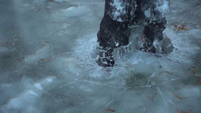 Boy jumping on thin ice, slow motion 250 fps