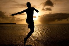 Boy jumping to the sea Stock Photography