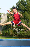 Boy Jumping on Trampoline Royalty Free Stock Photo