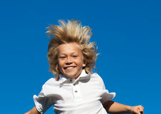 Boy jumping on a trampoline Stock Image