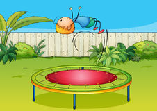 A boy jumping on a trampoline Stock Photography