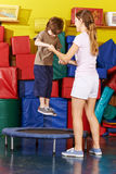 Boy jumping on trampoline in kindergarten Stock Photography