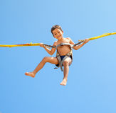 Boy jumping on trampoline Royalty Free Stock Image