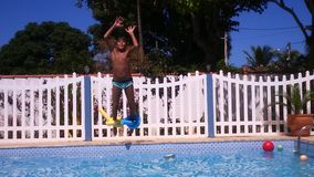 Boy jumping in water. In the piscina playing Royalty Free Stock Photos