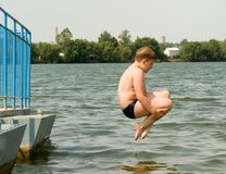 Boy jumps stock photo