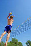 Boy Jumps High To Set Ball Royalty Free Stock Image