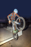 Boy jumps with his dirtbike in the skate park over a ramp Stock Image