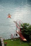 Boy jumps into the lake Royalty Free Stock Photography