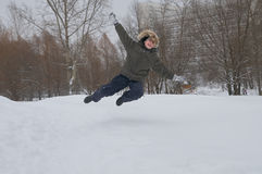 Boy jumps over the snow Royalty Free Stock Photo