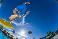Boy jumps into the pool Stock Images