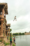 Boy jumps from Sarkhej Roza, Ahmedabad, India. Royalty Free Stock Image