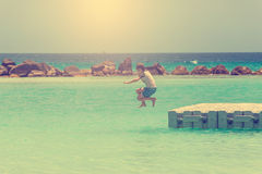 Boy jumps into the sea Royalty Free Stock Images
