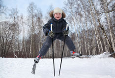 Boy jumps and spreads legs on cross-country skis Royalty Free Stock Images