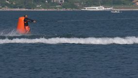"""Wakeboard Man Jump Motorboat Fall. A boy jumps the wake and fall in water during the """"Wake Zone Cup"""" on 1 July 2108 in Lake Como Italy stock video"""