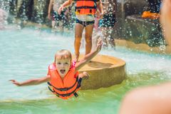 A boy jumps into the water in a pool royalty free stock image