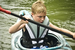 Boy in Kayak/Concentration stock photos