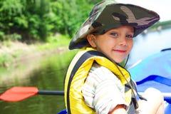 Boy kayaking Stock Images