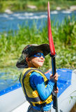 Boy kayaking on the river Stock Photography