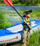 Boy kayaking on the river Royalty Free Stock Photo