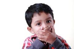 Boy keeping mum Stock Images