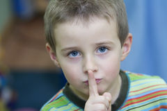 Boy keeping silent Stock Image
