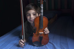Boy keeping a violin Stock Photos