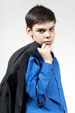 The boy keeps his jacket and looks Stock Images