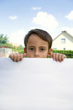 Boy keeps sheet of paper stock image