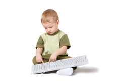 Boy with keyboard Royalty Free Stock Images