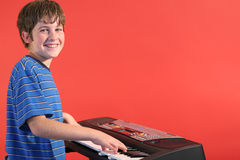Boy on keyboard left Royalty Free Stock Image