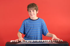 Boy on keyboard straight Stock Image