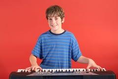 Boy on keyboard straight Stock Image