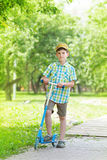 Boy with kick scooter Stock Photo