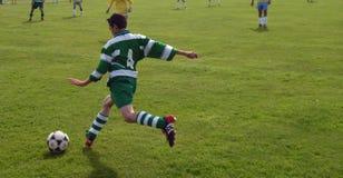 Boy kicking ball. Teenage boy kicking football royalty free stock photos