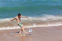 Boy Kicking Ball Beach Royalty Free Stock Photography