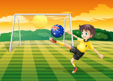 A boy kicking the ball with the flag of Australia Stock Image