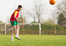 Boy kicking a ball at goal Stock Images