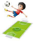 A boy kicking the ball Stock Photography